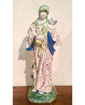 Scultura in maiolica raffigurante Madonna con Bambino.Iscrizione sulla base : rosa mystica.Manifattura di Angelo Minghetti.Bologna.