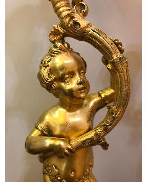 Coppia di flambeaux in bronzo dorato Francia XIX sec.