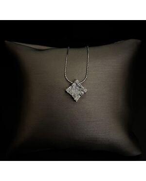 Pendente con  Diamanti  taglio principessa  baguette  e  rotondo.
