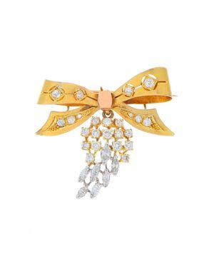 """Spilla """"fiocco"""" in oro con diamanti"""
