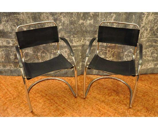 Quattro sedie cuoio e acciaio